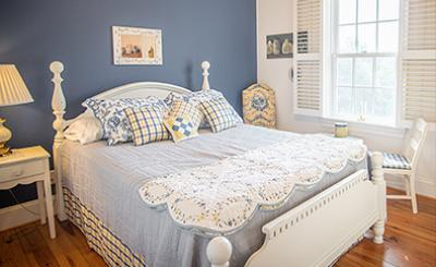 Bed with White Bedspread